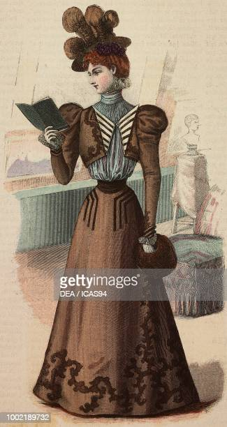 Woman wearing a visiting dress with puffed sleeves hat with bow and fur sleeve BrunCailleux design coloured engraving from La Mode Illustree No 45...