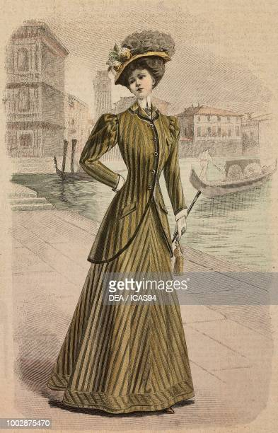 Woman wearing a visiting suit English Pekin fabric long jacket and a hat with flowers creation by Amy Linker and Co gondolas in Venice in the...