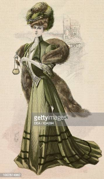 Woman wearing a walking or visiting dress green Drap fabric semiformal skirt dovetail jacket fur stole and a hat with feathers creation by High Life...