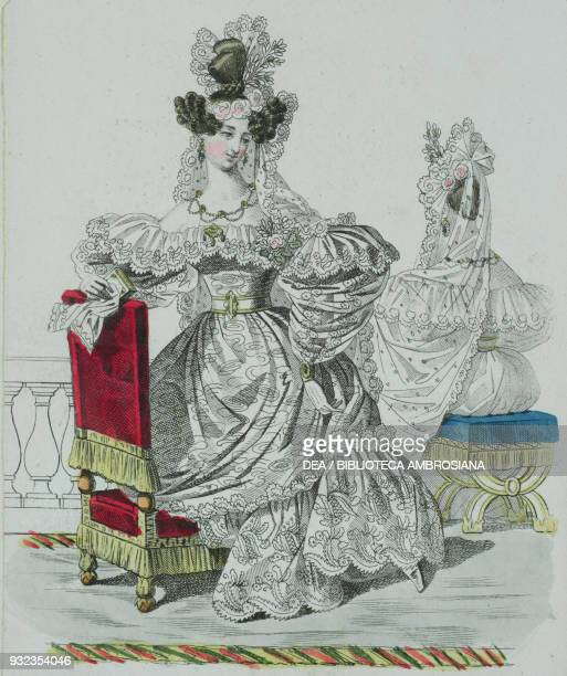 Woman wearing a wedding dress with Greek floral motifs puffed sleeves richly decorated with lacework and lace and lightcoloured flowers and long lace...
