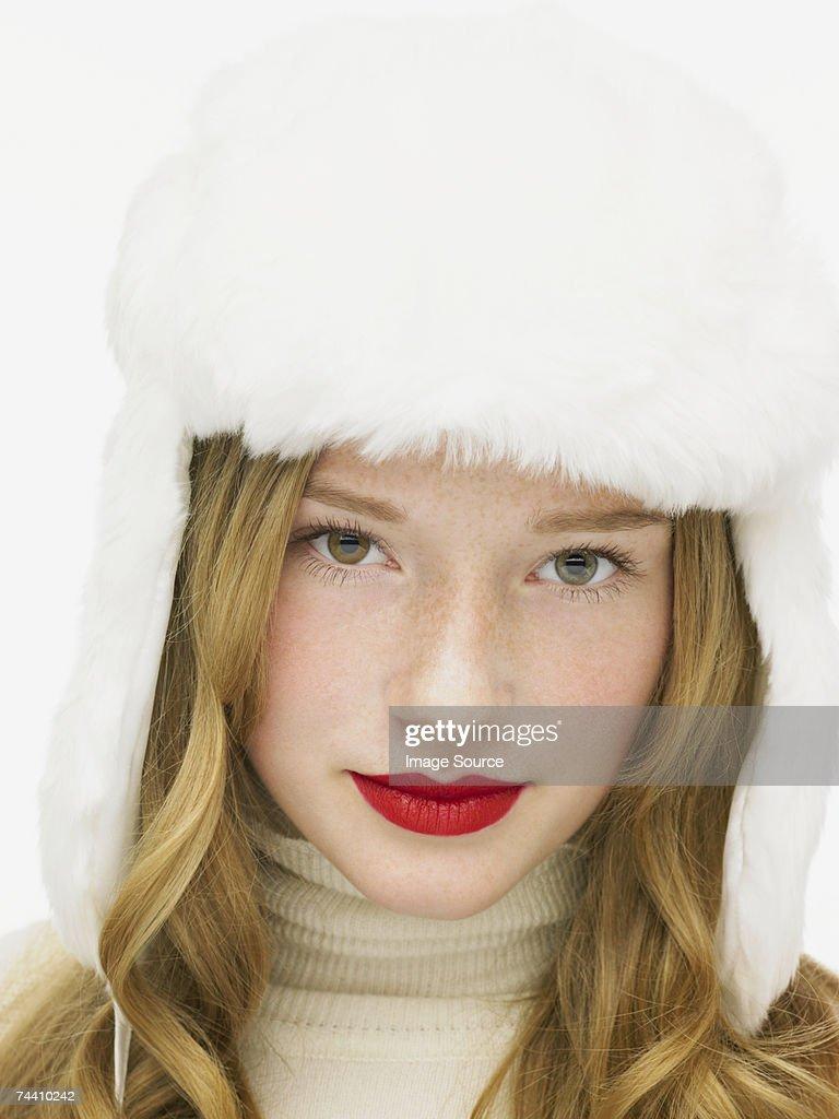 Woman wearing a white furry hat : Stock Photo
