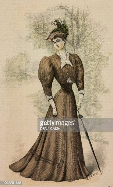 Woman wearing a woolen walking dress bolero with lapels and lace cuffs and a hat with feather umbrella creation by Martial and Armand colored...