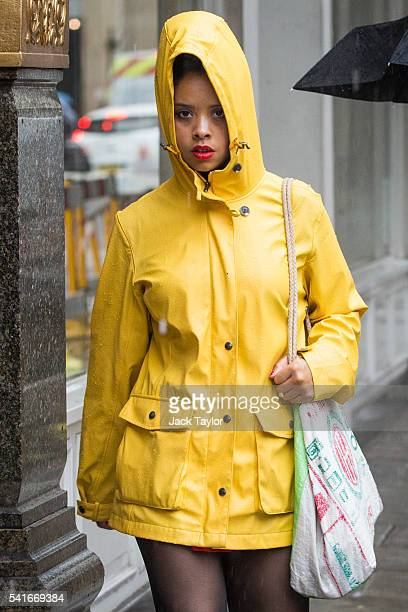 A woman wearing a yellow raincoat walks through the rain on June 20 2016 in London England The first day of British Summer is marked by rainy weather...