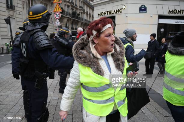 A woman wearing a yellow vest reacts on the Champs Elysee avenue on December 29 2018 during a demonstration called by the yellow vests movement to...