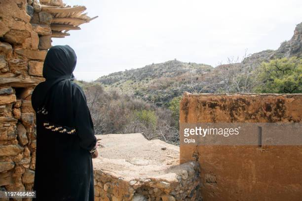 woman wearing abaya and sheila in oman - burka stock pictures, royalty-free photos & images