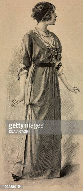 Woman wearing an afternoon dress draped skirt corset with trimmings and Vneck creation by Martial and Armand engraving from La Mode Illustree No 8...