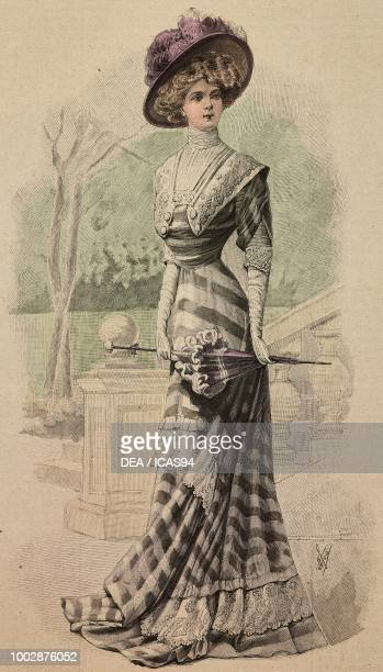 Woman wearing an afternoon dress in grey Crepe de Chine with tone on tone stripes Valenciennes lace inserts and a hat with feathers creation by...