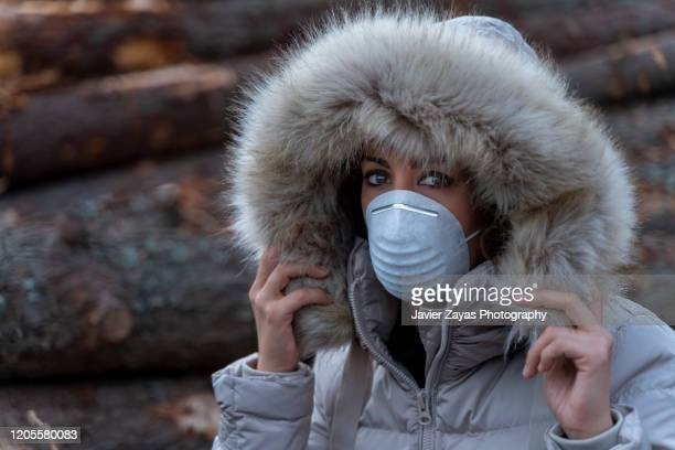woman wearing an allergy mask - coronavirus winter stock pictures, royalty-free photos & images