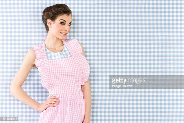 woman wearing an apron - checked dress stock pictures, royalty-free photos & images
