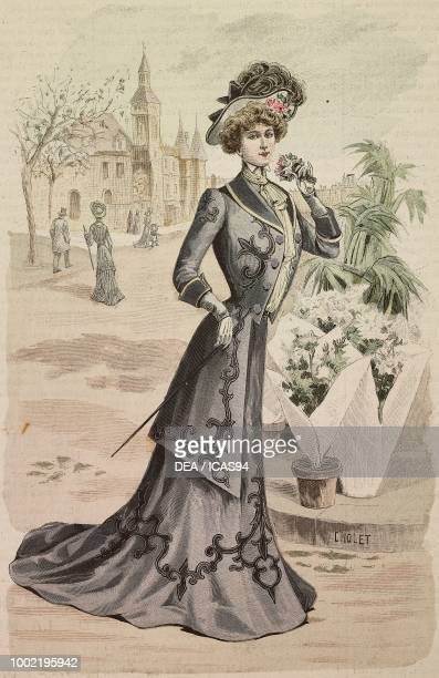 Woman wearing an autumnal walking dress with a semitrain skirt and long jacket models by Mademoiselle Louise Piret engraving by Cholet from La Mode...