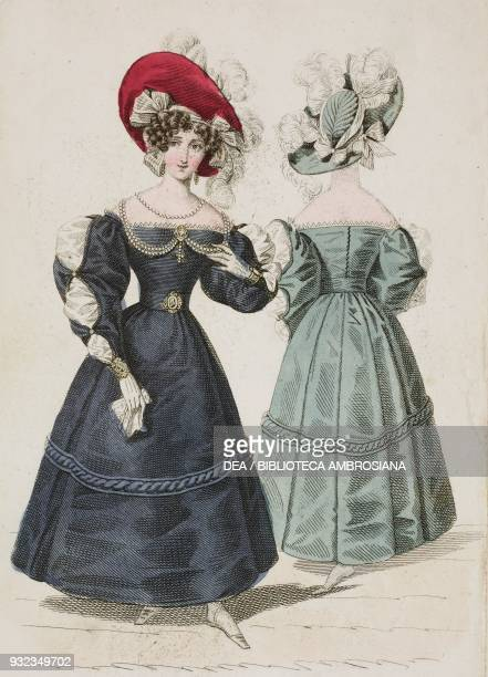 Woman wearing an elegant blue dress with puffed sleeves and red hat adorned with feathers and lightcoloured ribbons and a Woman wearing the same...