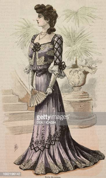Woman wearing an evening dress crepe de Chine skirt velours inserts creation by Mademoiselle Louise Piret engraving from La Mode Illustree No 47...