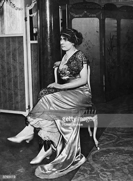 Woman wearing an evening dress with culottes under a satin overskirt.