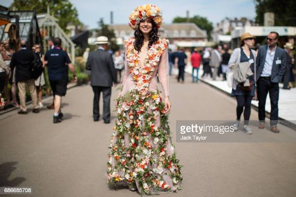 A woman wearing an outfit decorated with flowers poses at the Chelsea Flower Show on May 22 2017 in London England The prestigious Chelsea Flower...