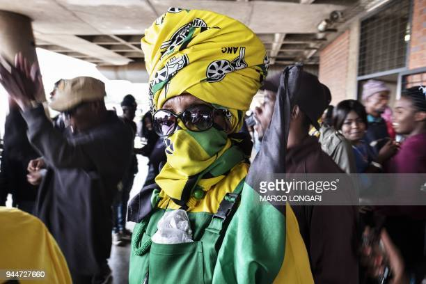 A woman wearing ANC regalia attends a memorial service for the late South African antiapartheid campaigner Winnie MadikizelaMandela exwife of former...