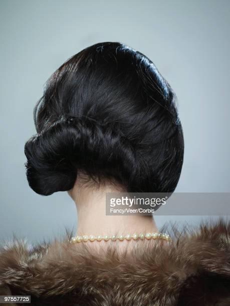 Woman wearing asymetric retro updo