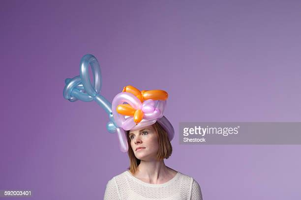 Woman wearing balloon hat