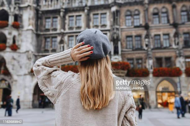 woman wearing beret by new town hall in munich, germany - munich stock pictures, royalty-free photos & images