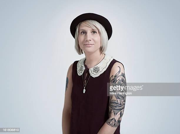 Woman wearing black dress looking direct to camera