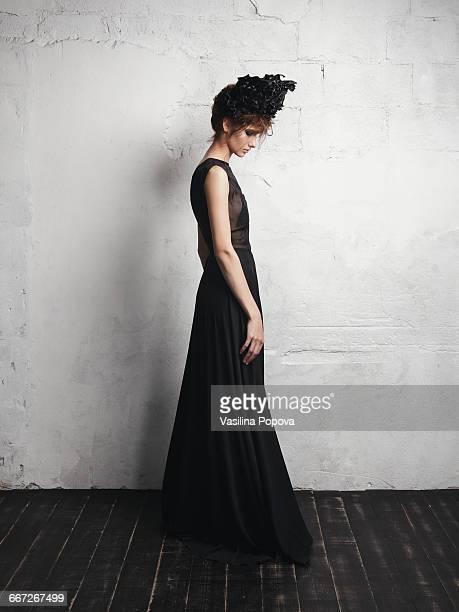 woman wearing black gown and wreath of flowers - sleeveless stock pictures, royalty-free photos & images