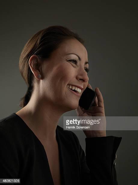 Woman wearing black on a dark background