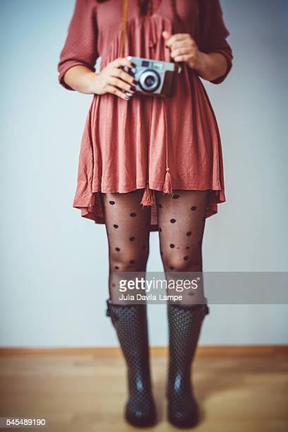 Woman wearing black polka dots stockings.