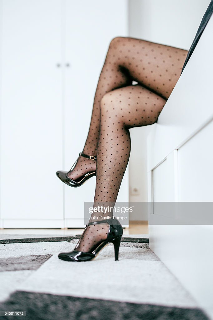 Woman wearing black polka dots stockings. : Stock Photo