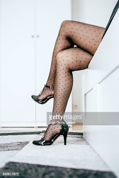 woman wearing black polka dots stockings. - nylon feet stock photos and pictures