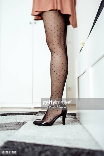 Woman wearing black polka dots stockings.