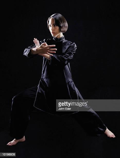 Woman wearing black, practicing Kung Fu