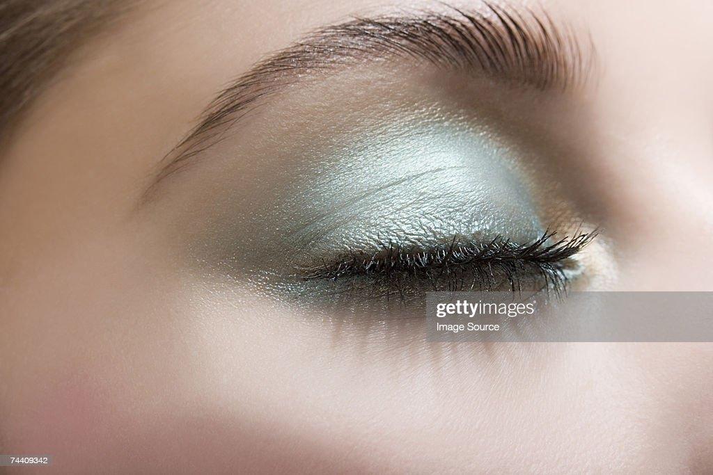 Woman wearing blue eye shadow : Stock Photo