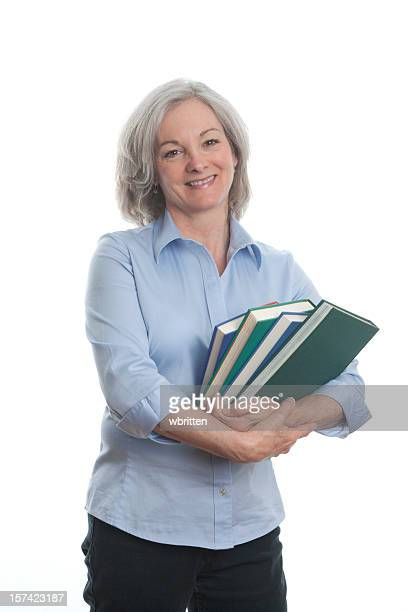 Woman wearing blue shirt clutching books