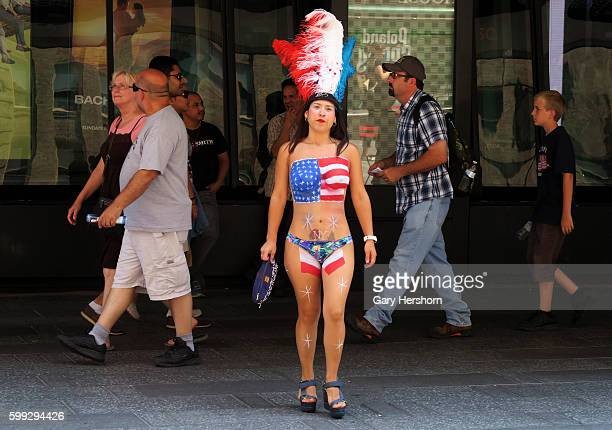A woman wearing body paint walks through Times Square in New York August 18 2015