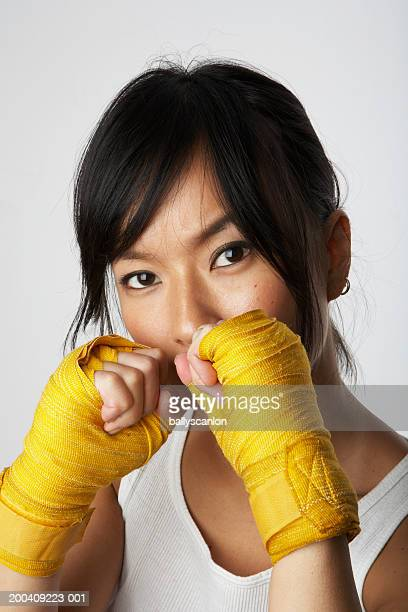 woman wearing boxing wraps - fighting stance stock pictures, royalty-free photos & images