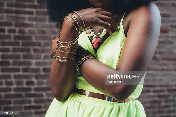 woman wearing bracelets, close-up - sleeveless stock pictures, royalty-free photos & images