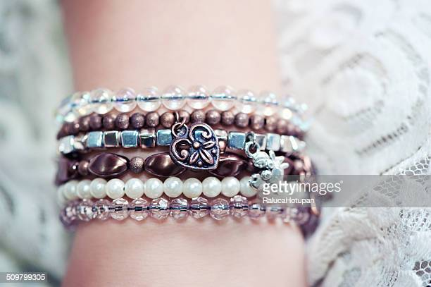 Woman wearing bracelets with charm