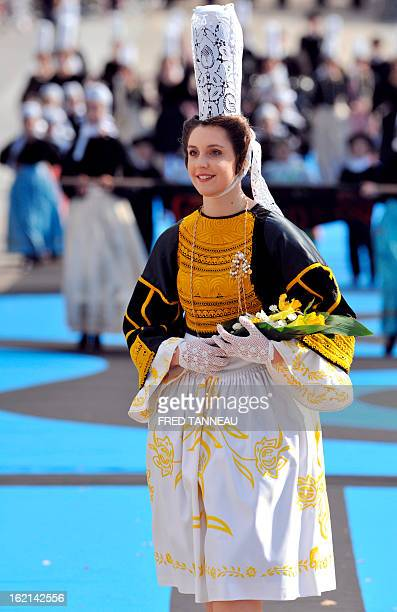 A woman wearing Breton traditional clothes parades on August 7 2011 in Lorient during the celtics nations Great Parade of the 'festival interceltique...