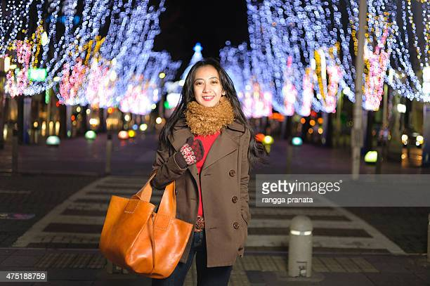 woman wearing brown coat - brown purse stock pictures, royalty-free photos & images