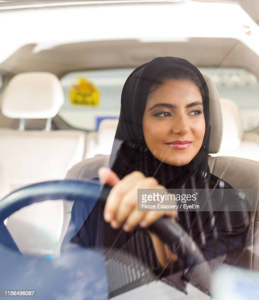 woman wearing burka while driving car - driver stock pictures, royalty-free photos & images