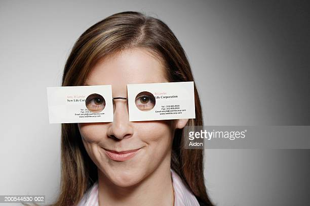 Woman wearing business card glasses, portrait