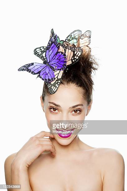 Woman wearing butterfly hair accessory