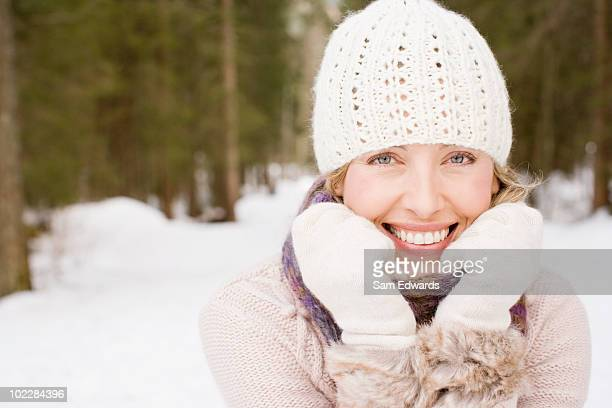 Woman wearing cap and gloves in snow