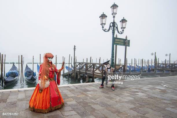 A woman wearing carnival costume poses in St Mark square during the 2017 Venice Carnival on February 17 2017 in Venice Italy The 2017 Carnival of...