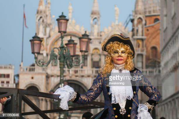 A woman wearing carnival costume poses in St Mark square during the 2018 Venice Carnival on January 28 2018 in Venice Italy The theme for the 2018...