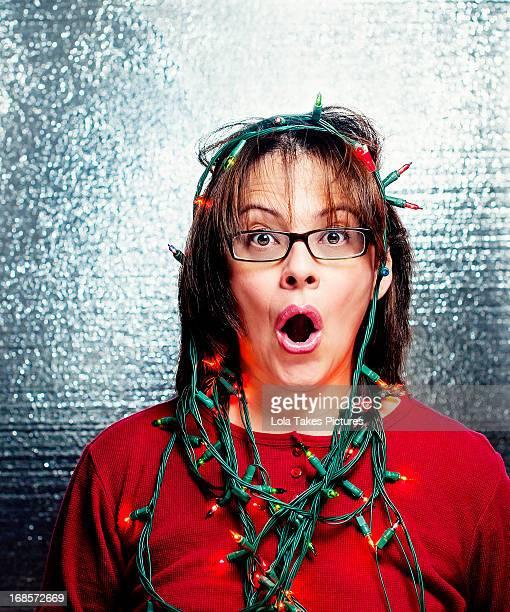 Woman wearing Christmas lights
