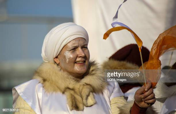 A woman wearing costume seen taking part in the Epiphany procession also know as Three Kings Day The Catholic feast day remembered the visit of the...