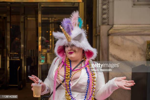 a woman wearing costumes in the street during the mardi gras celebration at new orleans carnival, louisiana, usa - mardi gras fun in new orleans stock photos and pictures