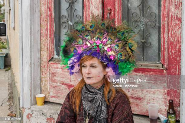 a woman wearing costumes in the street during the mardi gras celebration at new orleans carnival, louisiana, usa - mardi gras parade stock photos and pictures