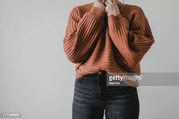 woman wearing cozy sweater and jeans - jumper stock pictures, royalty-free photos & images
