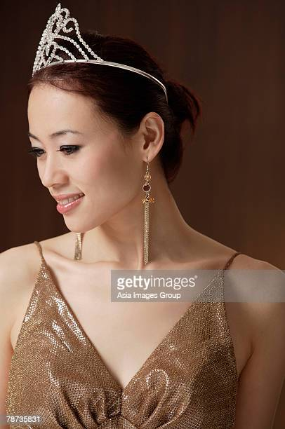 woman wearing crown, looking away from camera, beauty queen